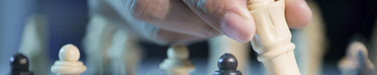 Photo of a hand moving a chess piece